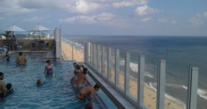 Take her to a rooftop pool or bar!